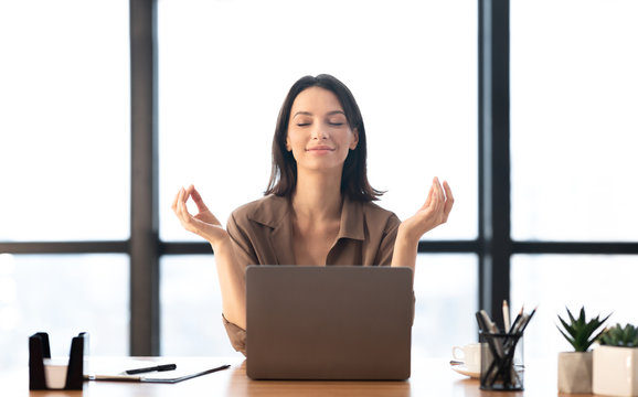 Girl meditating in office coping with stress