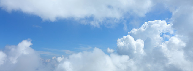panorama image, fluffy white cloud moving above dream sky background