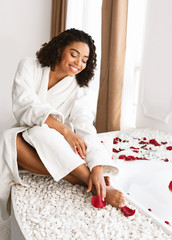 Sensual black elegant woman in spacious modern bathroom