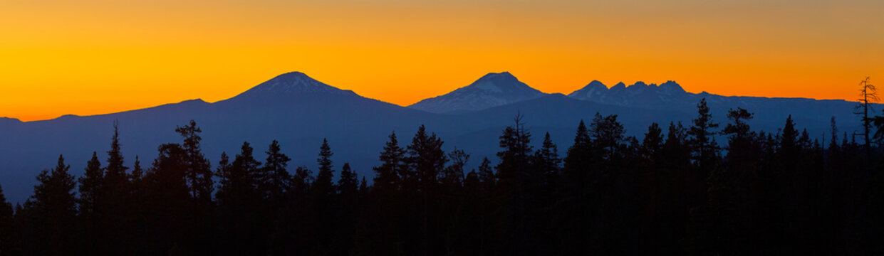 Colorful panoramic view after sunset with Mt Bachelor and Sisters Mountains near Bend in central Oregon.