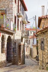 Cobbled alley and stone houses in the mountain town of Arachova at the foot of Mount Parnassos in Viotia, Greece.