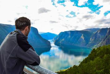 Man on the Stegastein viewpoint in Norway.