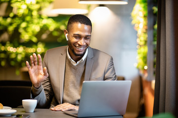 Smiling black business man making video call to family