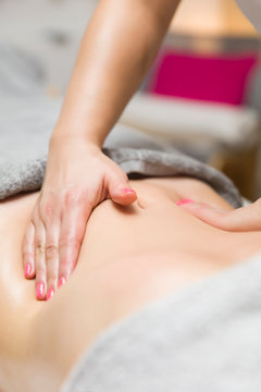 Woman having an professional massage of the abdomen