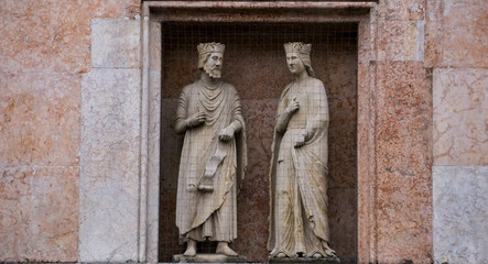 King Solomon and Queen Sheba, statues on a facade of the Baptistery in Parma, Italy