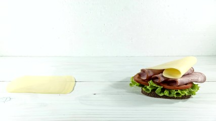 Fototapete - make sandwich, bread, sausage, ham, lettuce, cheese, sauce, tomato. Time lapse. Close up