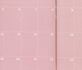 Close up of a pink pocket calendar that is blank