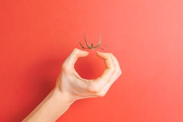 Invisible tomato. Creative concept. Illusion. Red background.