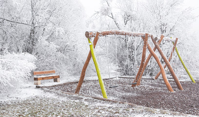 Playground in the park in winter