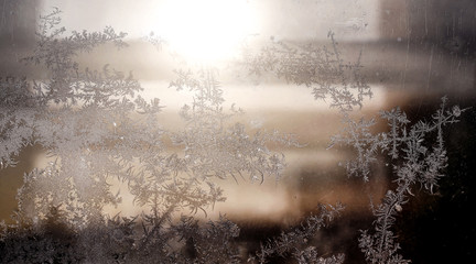 Frosty natural pattern on winter window, ornamental frost on the glass.