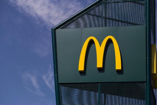 McDonald's logo. McDonald's is the world's largest chain of hamburger fast food restaurants