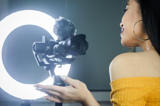 Female vlogger doing a video