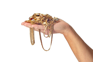 Woman's Hand Holding Gold Jewelry