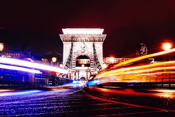 View to Chain bridge and city traffic. Beautiful evening or night scene of illuminating ancient architecture. Fotomurales