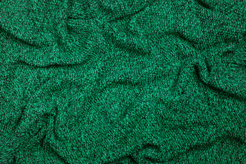Emerald color knitted woolen fabric texture