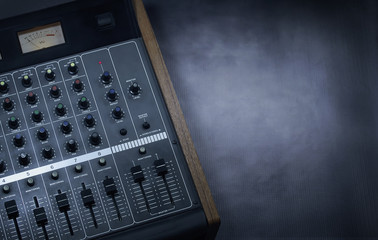 Close up shot of an analog studio mixer with copy space for titles or text