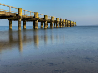 Wooden pier at the shore of the ocean