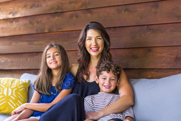 Portrait of a Hispanic mother and her children.