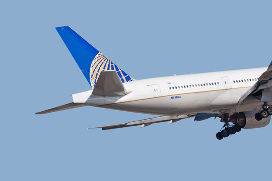 Chicago, USA - January 31, 2018: A tail close-up of a United Airlines Boeing 777 landing at O'Hare International Airport.