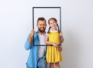concept of the family. father and child to daughter near empty wall