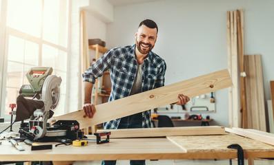 Fototapeta young male carpenter working in  workshop obraz