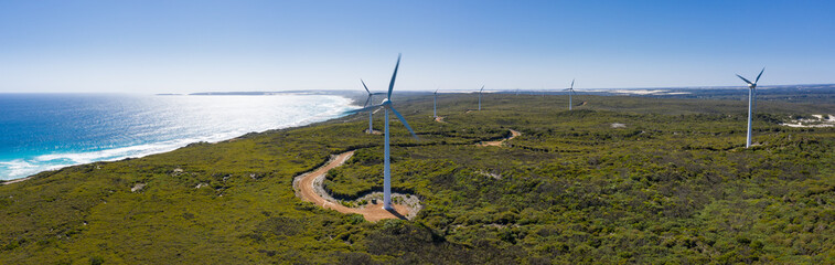Aerial panoramic view of the wind turbines looking towards the ocean on the coast at Esperance Wind Farm in Western Australia
