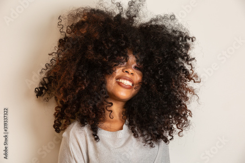 White girl with afro Allure Catches