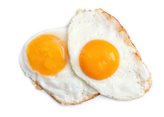 Deurstickers Gebakken Eieren Tasty sunny side up eggs on light background