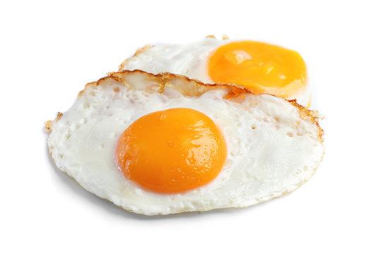 Tasty sunny side up eggs on light background