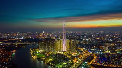 Fototapete - Day to night Hyperlaspe or Dronelapse of Ho Chi Minh City skyline in Vietnam