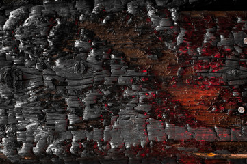 Keuken foto achterwand Brandhout textuur Burnt wooden wall texture colored with red light. Burned scratched hardwood surface. Smoking wood plank background. Dark Burned wooden texture empty horizontal surface, copy space. Selective focus.
