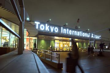 Tokyo, Japan - December 5, 2018: Illuminated logo sign at observation deck of Haneda Airport International Passenger Terminal at night.