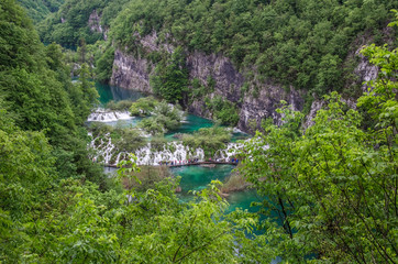 View from above of waterfall cascade with turquoise water in Plitvice Lakes National Park, Croatia