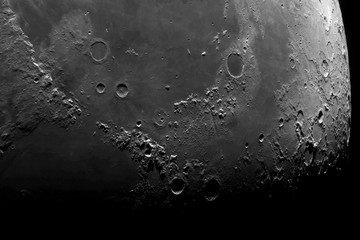 Astronomical photograph of the moon. Lunar surface through a telescope. The moon with a large increase. Craters after hitting meteorites. The Moon is the Earth's satellite. Photos from the lunar orbit