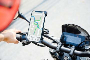 GPS APP screen smartphone installed at motorcycle handle bar for navigator. Papier Peint