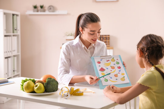 Little girl visiting professional nutritionist in office