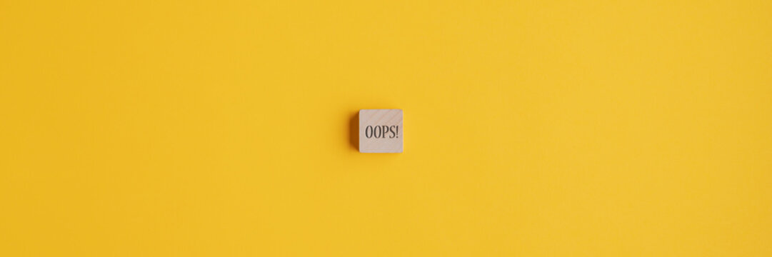 Oops sign over yellow background