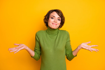 I don't know. Photo of beautiful lady spread hands shrug shoulders careless ignorance expression said bad wrong thing wear casual green turtleneck isolated yellow color background