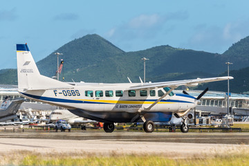 St. Maarten, Netherlands - December 17, 2018: The Cessna 208B Grand Caravan airplane preparing for takeoff at Princess Juliana International Airport in the Caribbean island of Sint Maarten - Saint Mar
