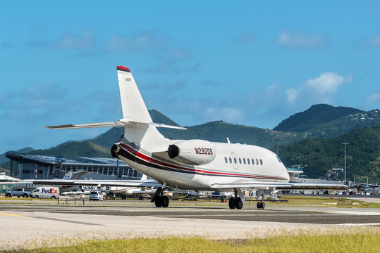 St. Maarten, Netherlands - December 17, 2018: The Gulfstream G200 airplane preparing for takeoff at Princess Juliana International Airport in the Caribbean island of Sint Maarten - Saint Martin.