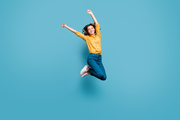 Fototapete - Full length body size view of nice attractive careless carefree cheerful cheery wavy-haired girl jumping rising hands up isolated on bright vivid shine vibrant green blue turquoise color background
