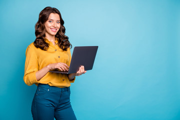 Fototapete - Portrait of her she nice attractive confident cheerful cheery wavy-haired girl holding in hands laptop creating web design isolated on bright vivid shine vibrant green blue turquoise color background