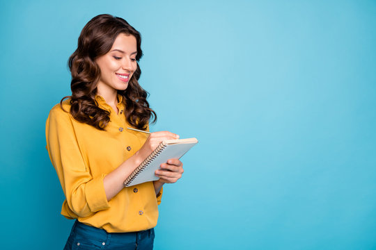 Portrait of her she nice attractive lovely pretty charming cheerful cheery wavy-haired girl making writing notes isolated over bright vivid shine vibrant green blue turquoise color background