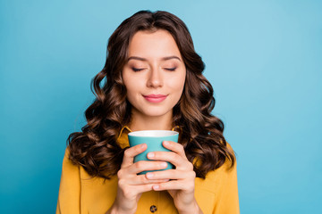 Close-up portrait of her she nice attractive cheerful cheery dreamy calm wavy-haired girl holding in hands latte cup isolated over bight vivid shine vibrant green blue turquoise color background
