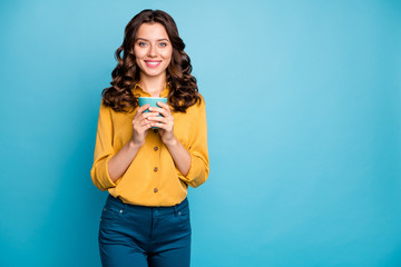 Portrait of her she nice attractive lovely cute charming cheerful cheery wavy-haired girl drinking warm milk isolated over bright vivid shine vibrant green blue turquoise color background