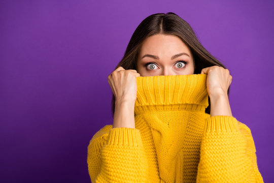 Close-up portrait of her she nice attractive lovely funny scared straight-haired girl hiding face in warm sweater isolated over bright vivid shine vibrant lilac violet purple color background