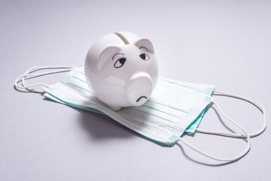 Sad piggy bank and set of Medical disposable masks