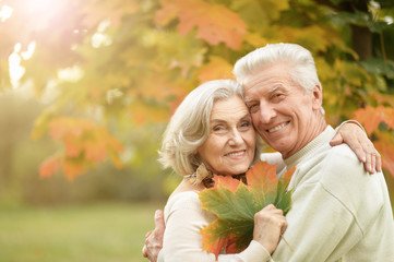 Portrait of beautiful senior couple embracing in the park