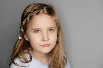 Close-up portrait of beautiful upset little girl Fototapete