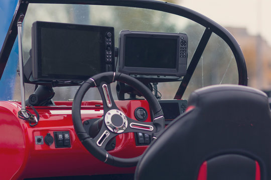 Instrument panel and steering wheel of a motor boat. Transport